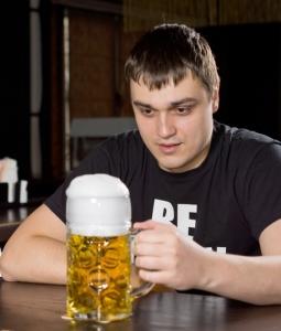 Man staring at a beer